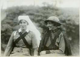 graphic is a black and white photo of two Canadian women wearing nurses uniforms from World War I